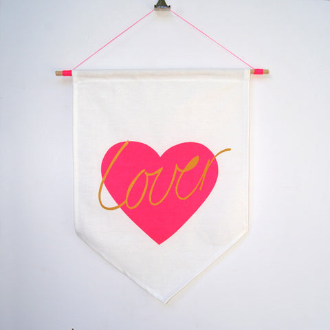 Neon pink 'LOVER' hand screen printed 100% cotton flag hung on dowel rod
