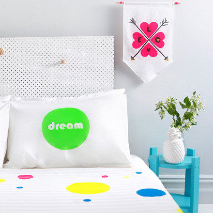 Neon green hand screen printed pillowcase perfect for the design savvy kid