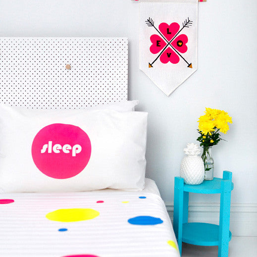 Neon pink hand screen printed 'sleep' pillowcase perfect for the design savvy kid