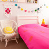 Gorgeous kids room with hot pink throw with gold pineapples on bed