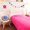 Gorgeous kids room with hot pink throw with gold arrows on bed
