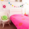 Gorgeous kids room with hot pink throw with gold spots on bed