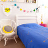 Gorgeous kids room with royal blue throw with gold arrows on bed