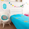 Gorgeous kids room with turquoise throw with gold spots on bed