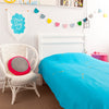 Gorgeous kids room with turquoise throw with gold arrows on bed