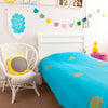 Gorgeous kids room with turquoise throw with gold pineapples on bed