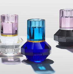3 crystal tea-light holders from Reflections Copenhagen, made of pink, dark blue, light blue, black, and clear crystal