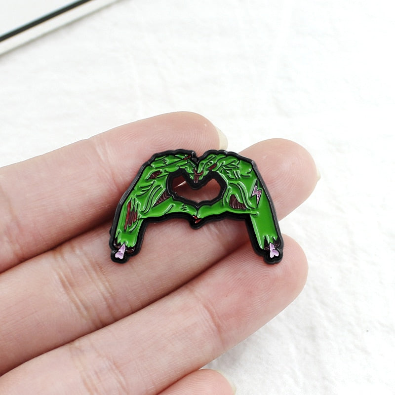 Skull Hands Heart-Shaped Enamel Pin