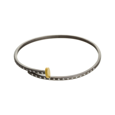 Modern Bezel Bypass Nail Bangle. With a Laid Back Luxe Look this Bangle is anything but Basic.