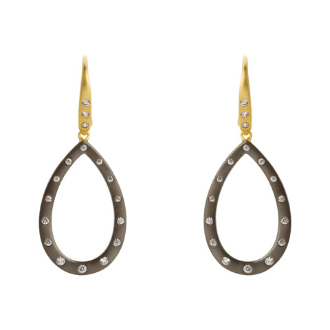 Modedrn Opend Bezel Teardrop Earring. An Effortless Addition to your Seasonal Staples.