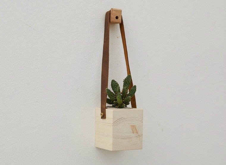 Simple and beautiful, these wood and leather hanging wall planters add a touch of colour and style making a great feature on any wall and making them a really original gift.