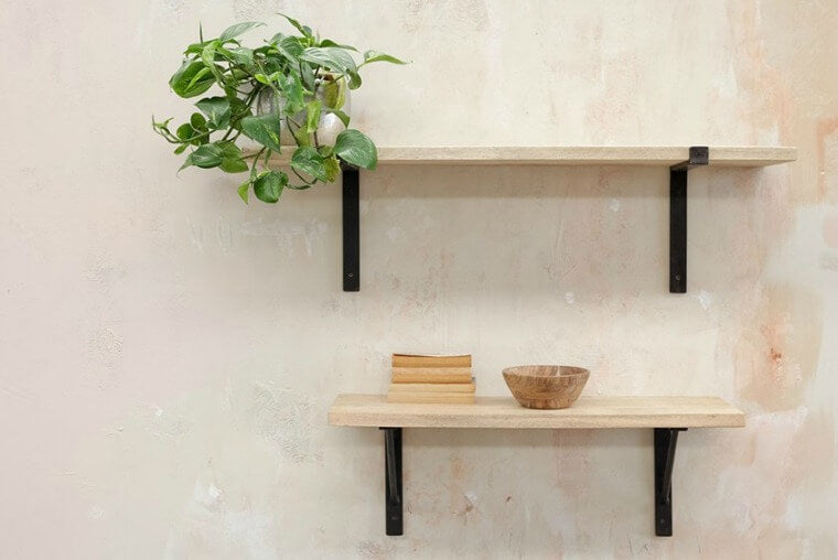These stylish Birwa shelves have a industrial look to them. The chunky solid mango wood shelf rests on a rustic iron shelf support.