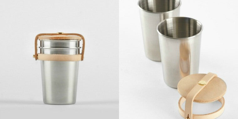 Two stainless steel cups secured together by a handmade leather casing and sturdy brass hardware. Stainless steel is durable and a safe alternative to plastic, making these cups a perfect accessory for picnics or outdoor activities. Practical, simple and aesthetically pleasing, it is another great product from Yield Design,