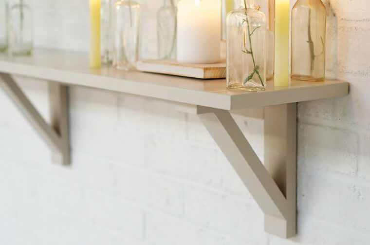 Devol This hand painted hardwood shelf has simple triangular brackets. It is equally useful in laundry room, kitchen, bathroom or hallway.