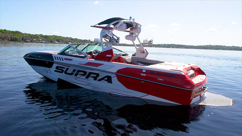 Red and White PWT Supra Boat on Water with JL Audio System