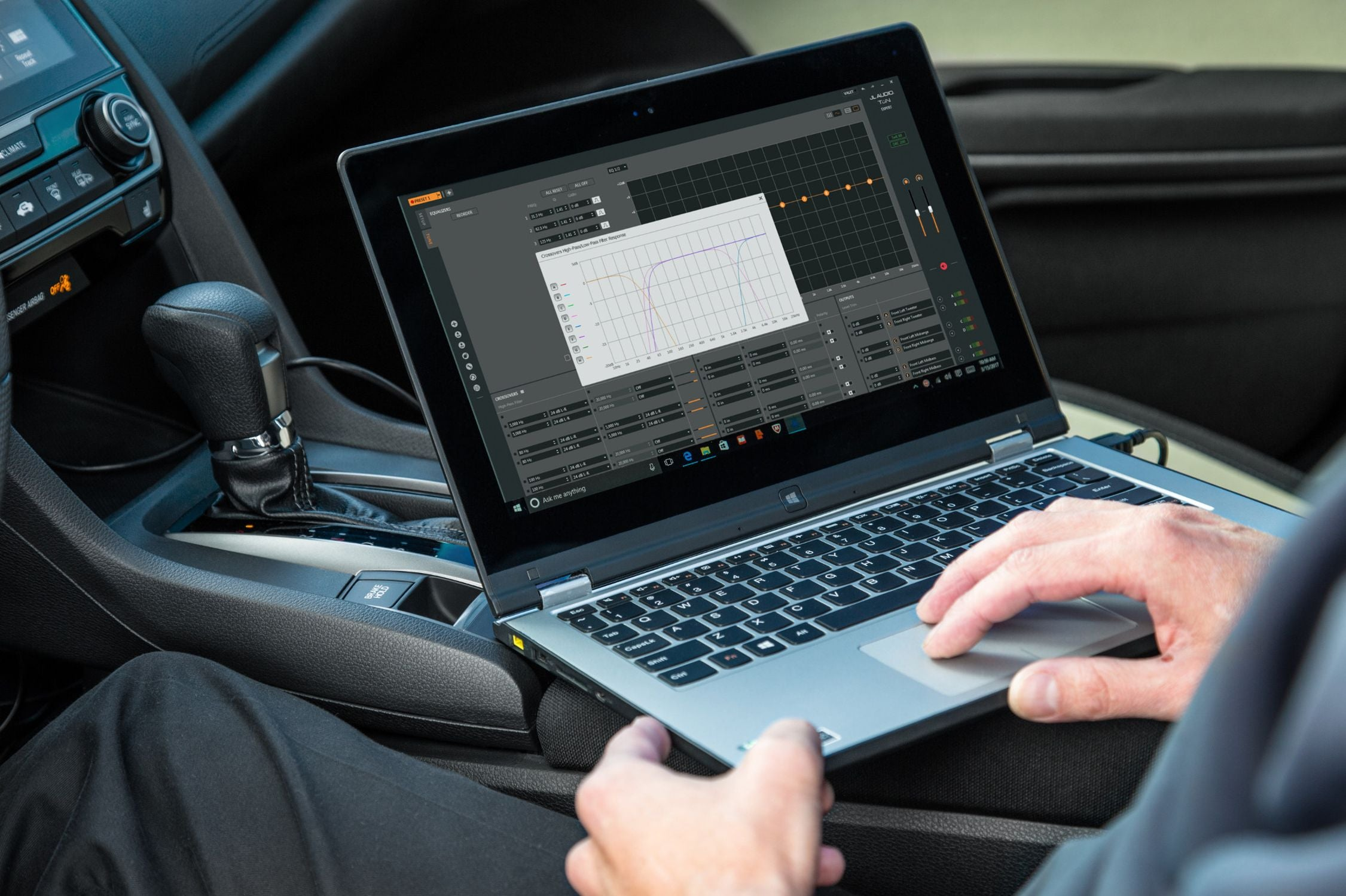 Hand on a Laptop Setting a Crossover with TüN Software in a Honda