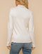 Corinne Ivory Ruffle Mock Neck Sweater