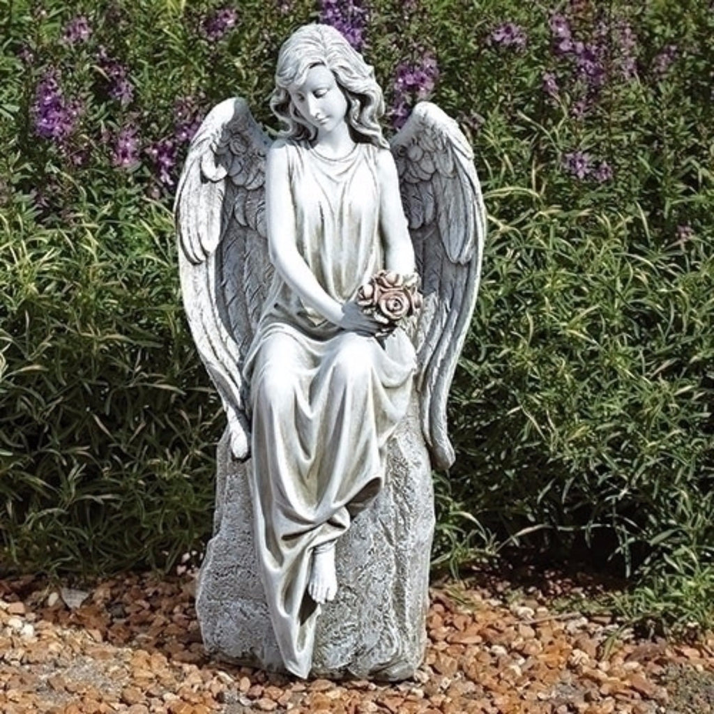 Seated memorial angel garden statue gravesite