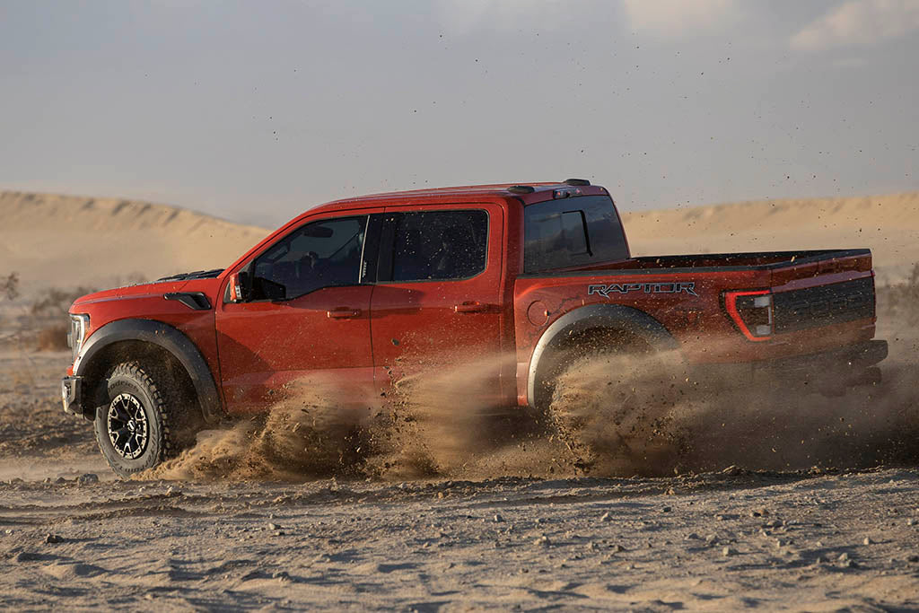 new ford raptor playing in the dirt
