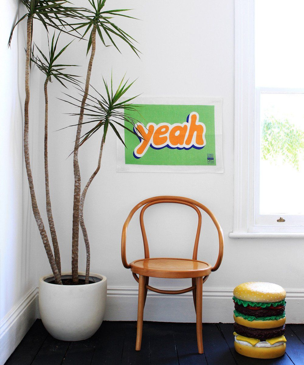 yeah tea towel by Jon Campbell