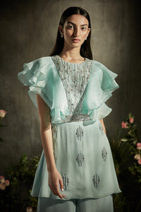 Ruffled embroidered top with flared pants