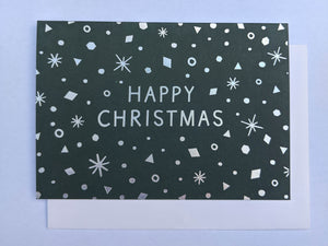 Green and silver snowing scene Christmas card