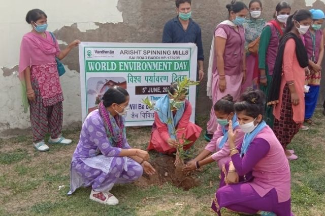 women at the anuna educational center planting a tree