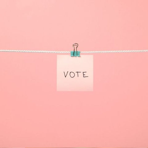 """post it on a string hanging saying """"vote"""""""