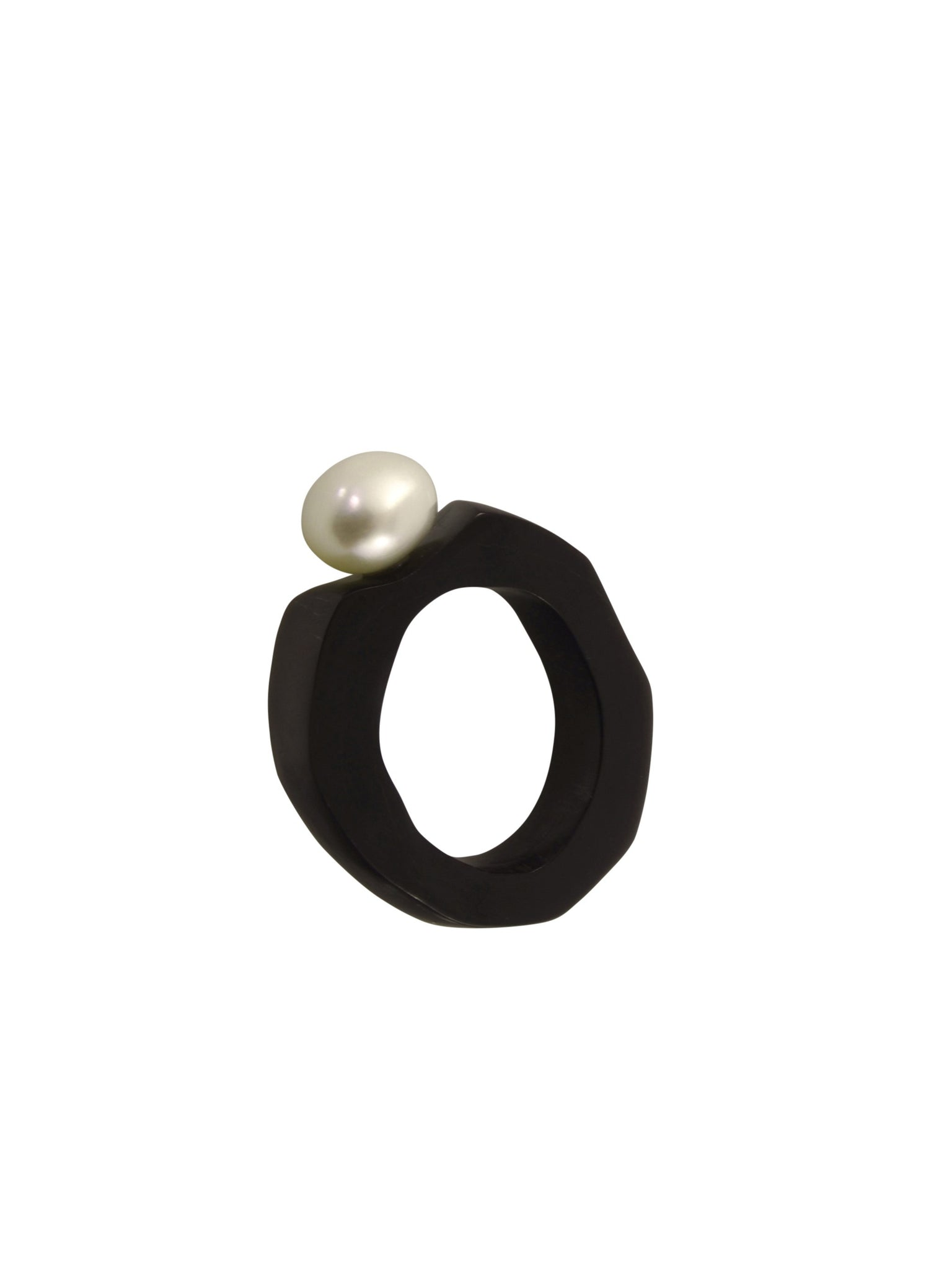 Polished buffalo horn is a wonderful material to wear in jewellery as it is so organic, light and warm to the touch. These rings are made from buffalo horn, pearl and sterling silver. Each one is custom made so please contact me for orders.