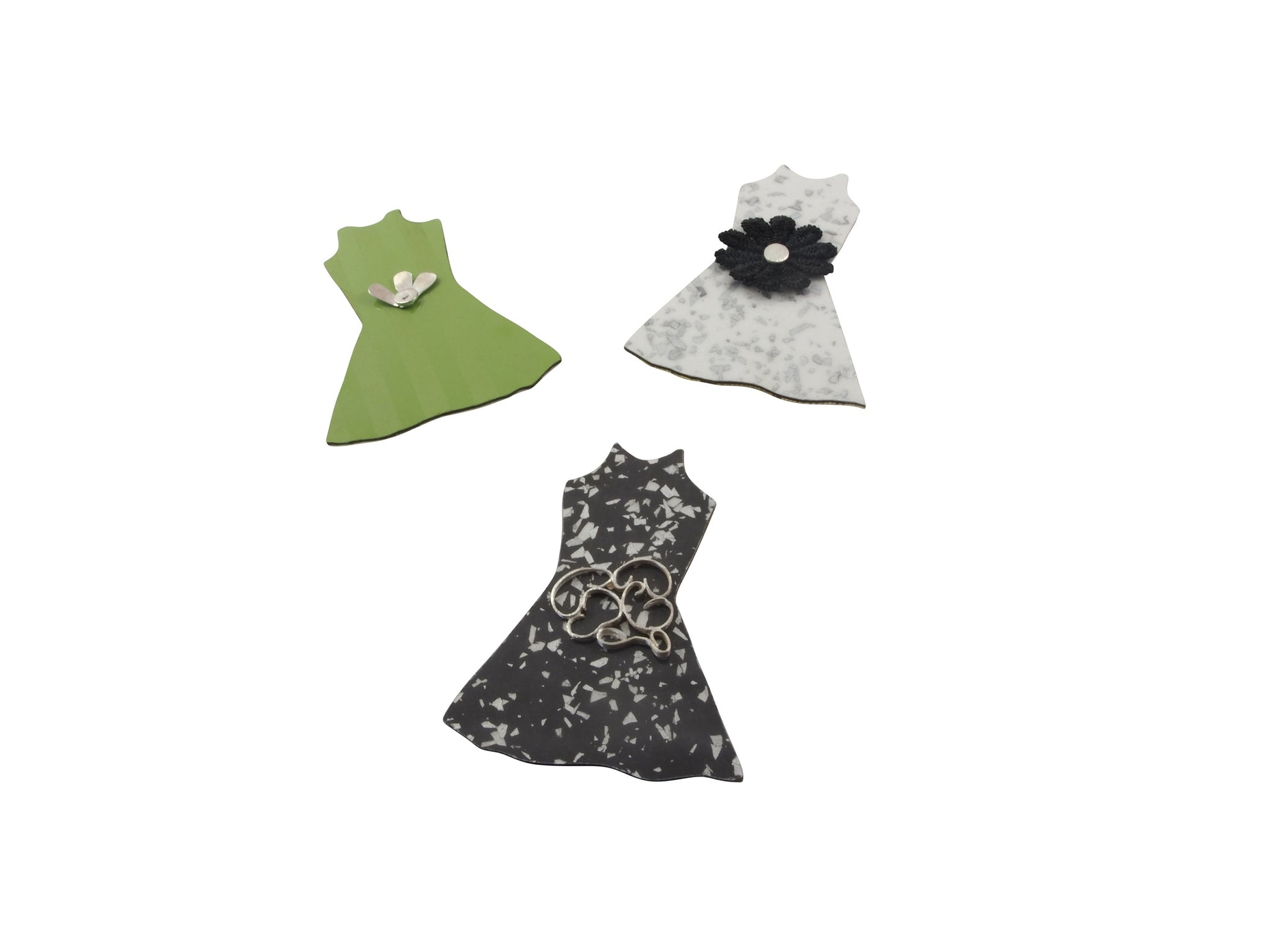 The dressmaker brooches