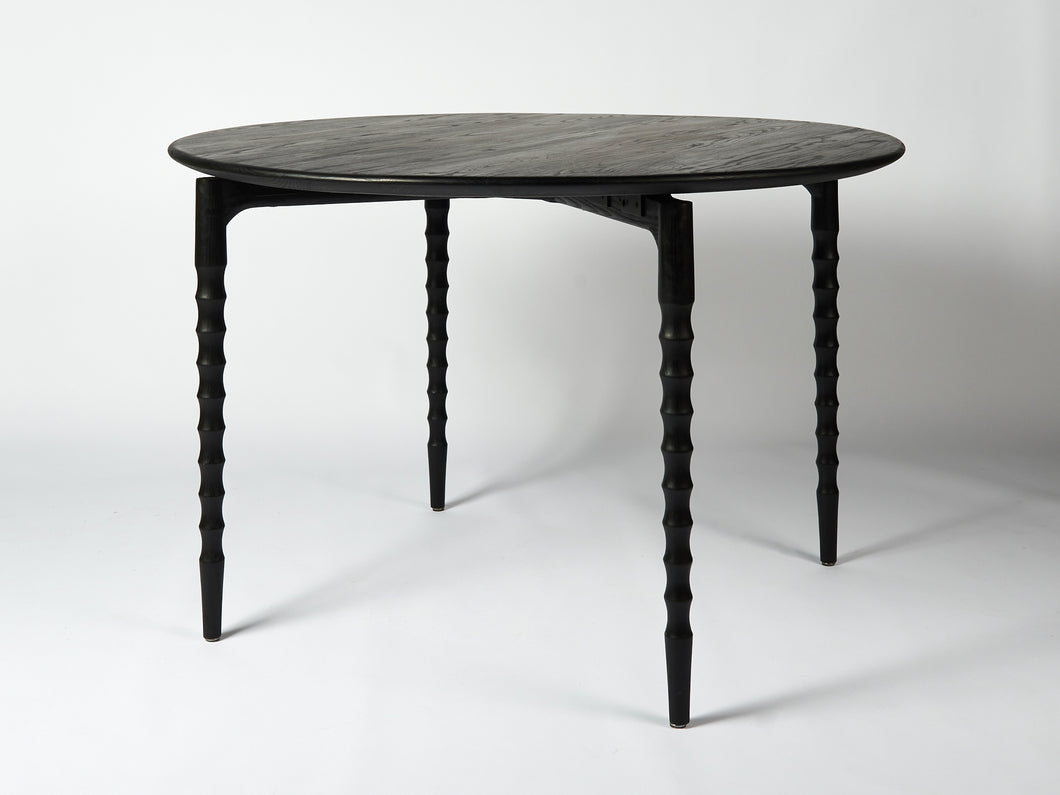 circular black wood dining table