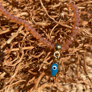 Smokey Coral Coloured Crystal Bracelet with Blue Fish Charm