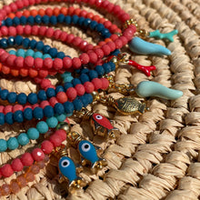 Load image into Gallery viewer, Smokey Coral Coloured Crystal Bracelet with Blue Fish Charm