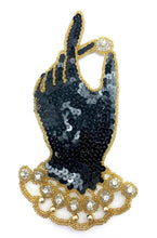 "Load image into Gallery viewer, Gloved Hand Holding Riches with Black, Gold Silver Sequins and Beads and Rhinestones 7"" x 4"""