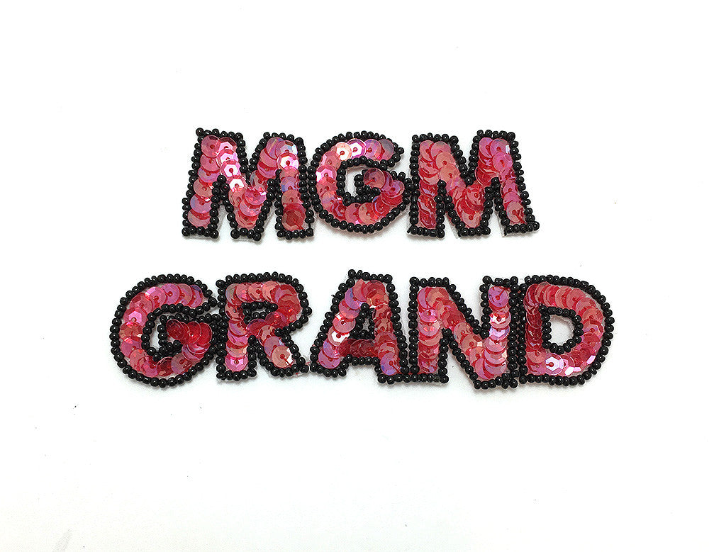 "MGM Grand Word Casino with Salmon Sequins and Black Beads  4.5"" x 1"""
