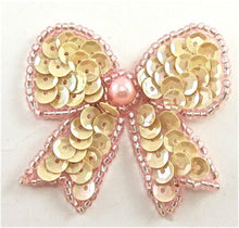 "Load image into Gallery viewer, Bow with Pinkish Yellowish Sequins and Pink Beads 1.75"" x 2"""