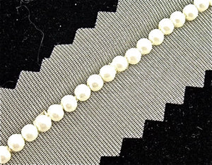 D_ WHITE BEADS WITH CREAM NETTING TRIM