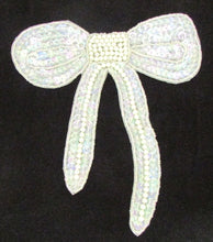 "Load image into Gallery viewer, Bow with Iridescent Sequins and White Beads 6""  x 6"""