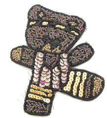 "Bear doing Aerobics with Purples and Peach Sequins and Dark Moonlight Beads  4"" x 3.5"""