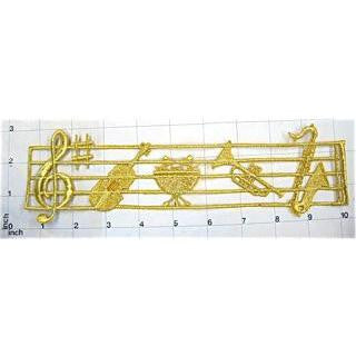 "Musical Instruments on Scale, Metallic Gold Embroidered Iron-On  9.75"" x 3'"