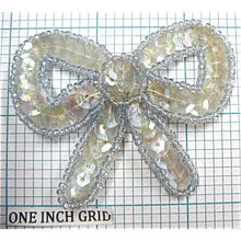 "Load image into Gallery viewer, Bow with Iridescent Lite Greenish Sequins and Lite Blue Beads 2"" x 2.5"""