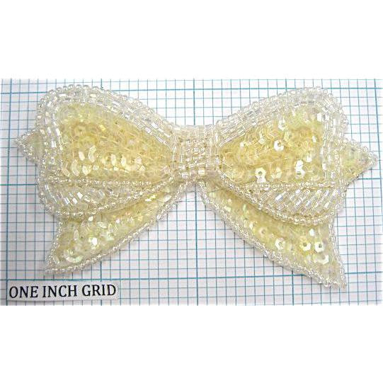 "Bow with Yellowish Sequins and Iridescent Beads  4"" x 2.25"""