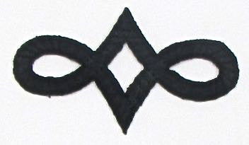 "Designer Motif, Black Embroidered Iron-On  2.75"" x 1.5"""