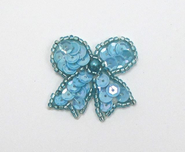 "Bow with Light Blue Sequins, Beads and Pearl  1.25"" x x1.25"""