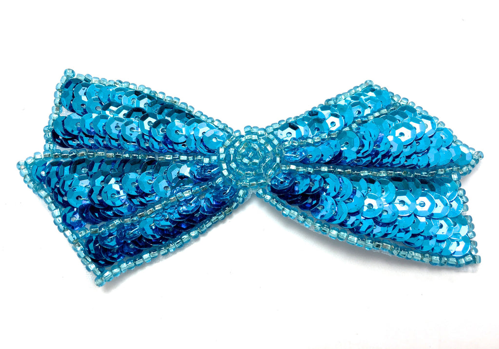 "Bow with Turquiose Sequins and Beads 4""x 2"""