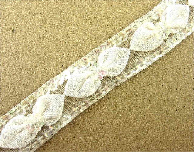 "Trim with Cotton Bows Center is Iridescent Flower Two Rows Iridescent Sequins 1"" Wide"