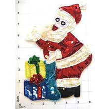 "Load image into Gallery viewer, Santa Bending over Presents 9"" x 6"""