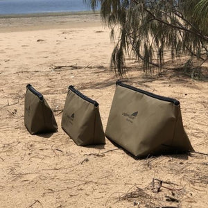 3 canvas fishing bags on beach side view YKK
