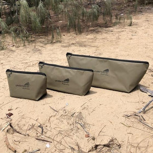 3 canvas fishing bags on beach underkover Australia