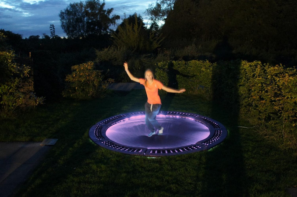 Purple trampoline lighting